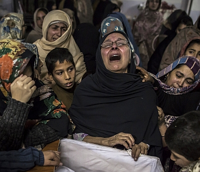 Women mourning in Peshawar.